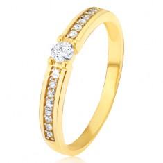 Inel din aur - zirconiu rotund transparent în mijloc, o linie subțire cu pietre pe lateral