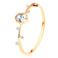 Inel realizat din aur galben de 14K - oval transparent cu margini crestate, zirconii mici