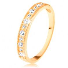 Inel lucios din aur galben de 14K - linie din zirconii transparente cu margine cu crestături