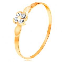 Inel din aur galben de 14K - floare compusă din patru zirconii transparente, frunze lucioase