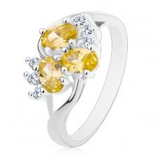 Inel de culoare argintie, brațe despicate, ovale galben-verzi, zirconii transparente