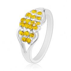 Inel de culoare argintie, brațe despicate, zirconii galbene rotunde