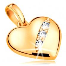 Pandantiv realizat din aur galben de 14K- inimă simetrică și proeminentă cu trei zirconii intr-o crestătură