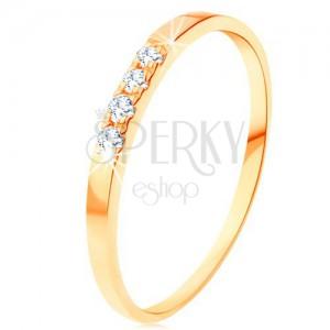 Inel din aur 585 - linie cu patru diamante transparente, brațe subțiri