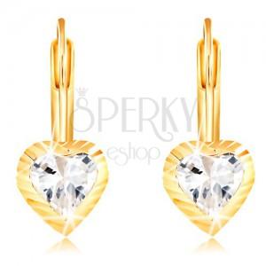 Cercei din aur galben 14K - inimă cu raze și zirconiu în centru