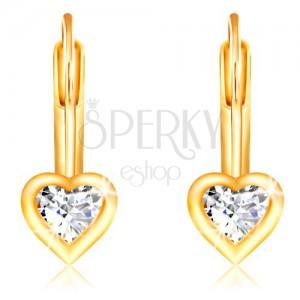 Cercei din aur galben 14K - inimă din zirconiu transparent cu margine lucioasă