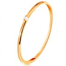 Inel realizat din aur galben de 9K - zirconiu transparent micuț, braţe striate delicat